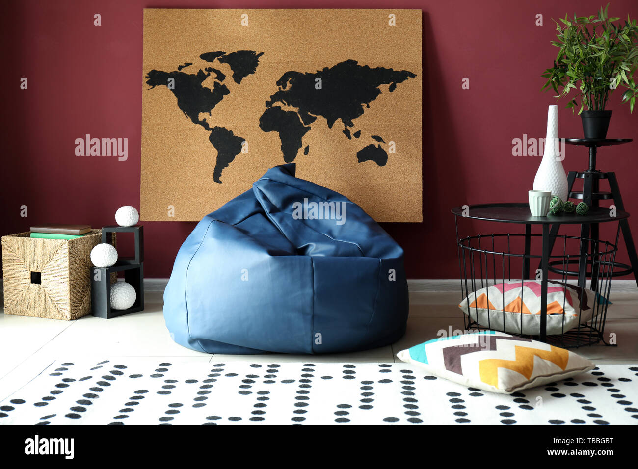 Interior of modern room with picture of world map on wall - Stock Image