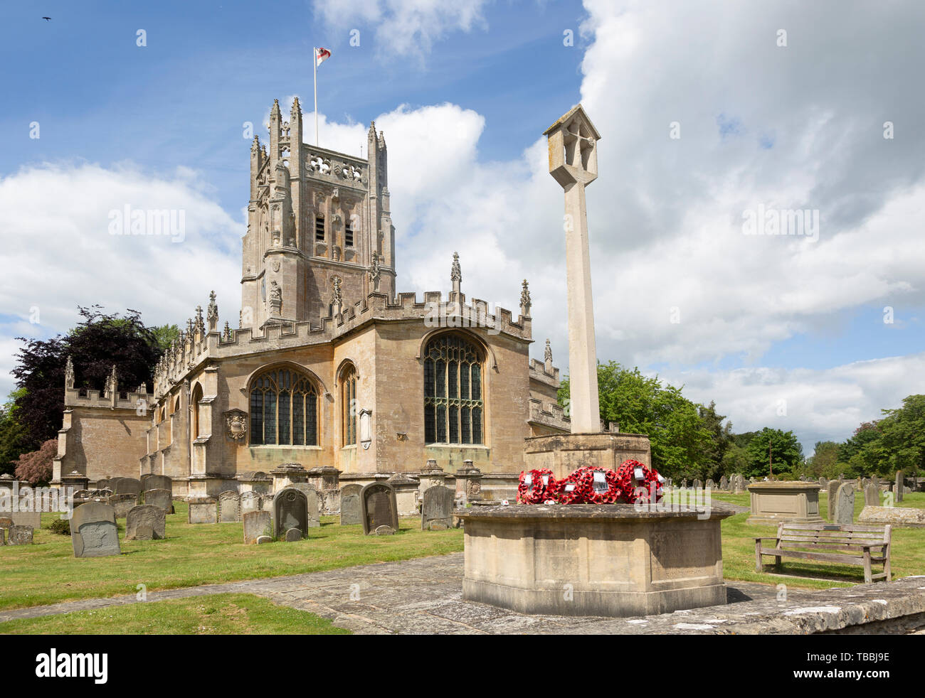Cotswolds historic stone building churchyard of Church of Saint Mary, Fairford, Gloucestershire, England, UK - Stock Image