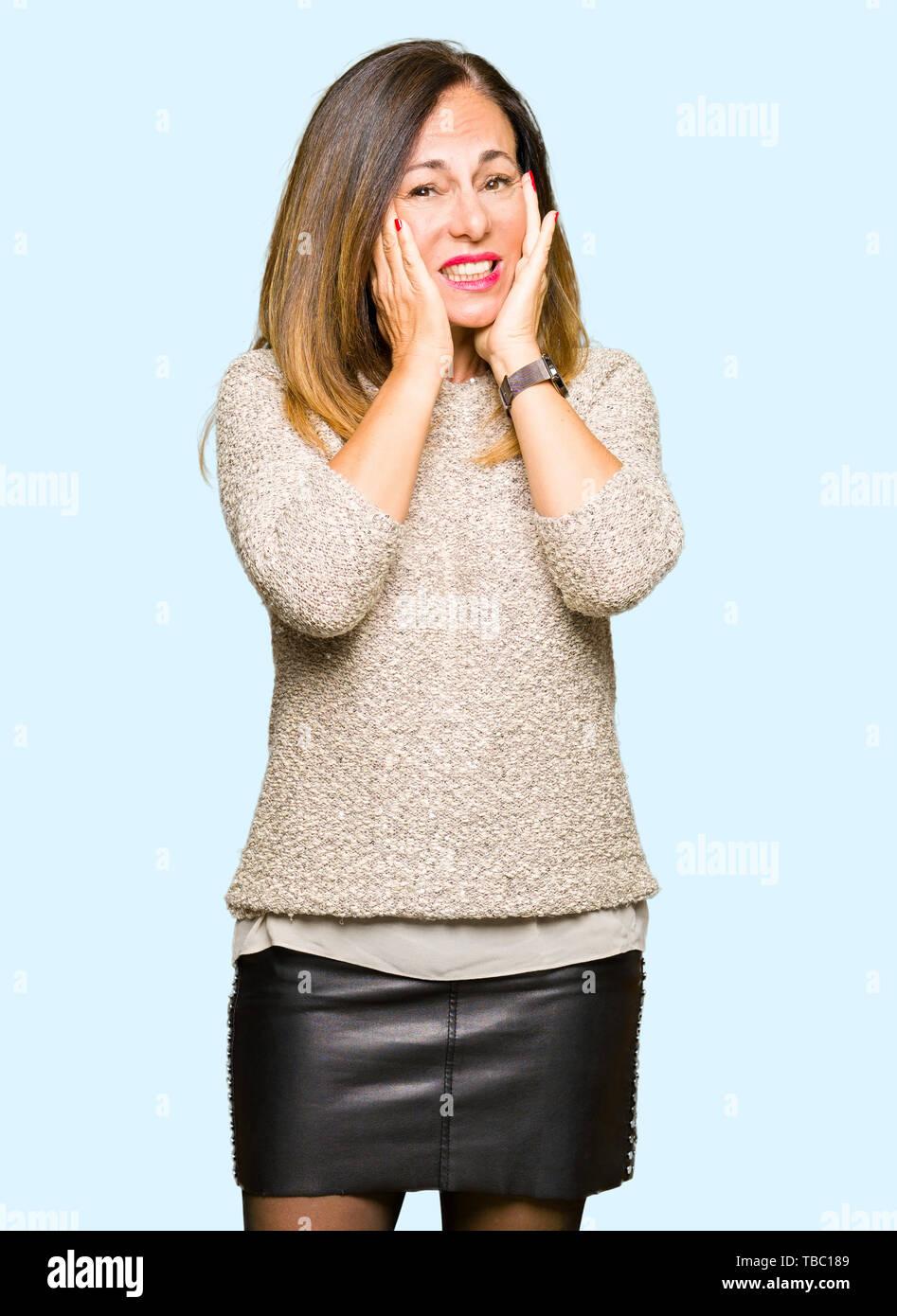 Beautiful middle age woman wearing fashion sweater Tired