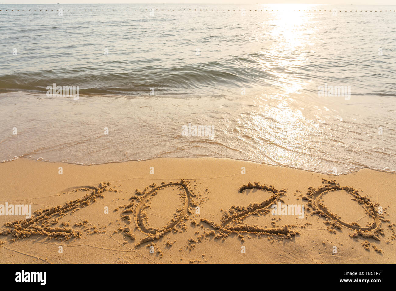 Happy New Year 2020 on the peaceful sand beach Stock Photo ...