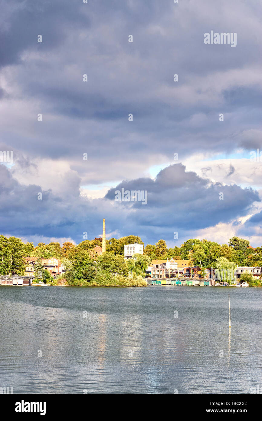 Old residential area at the Ziegelsee in Schwerin under dramatic clouds. Mecklenburg-Vorpommern, Germany - Stock Image
