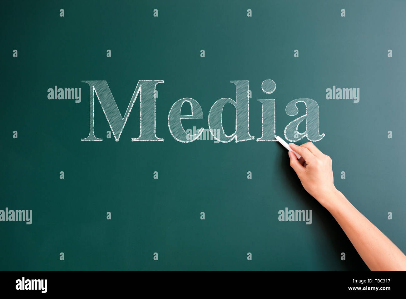 media written on blackboard - Stock Image