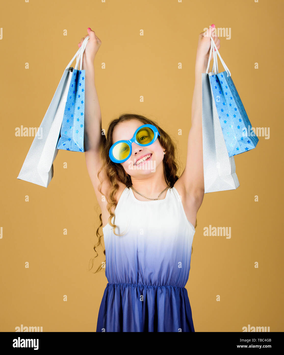 summer sales. Small girl fashion. black Friday discount. cyber Monday. Present and gifts buy. happy shopping girl with bags. happy birthday holiday. Beauty. Quality service. Home shopping. - Stock Image
