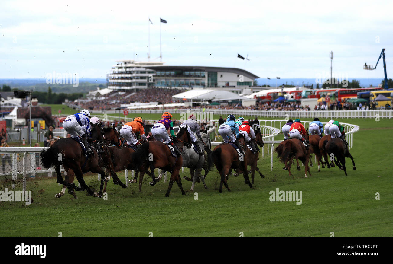 Runners and riders in the Investec Mile Handicap during Ladies Day of the 2019 Invested Derby Festival at Epsom Racecourse, Epsom. - Stock Image