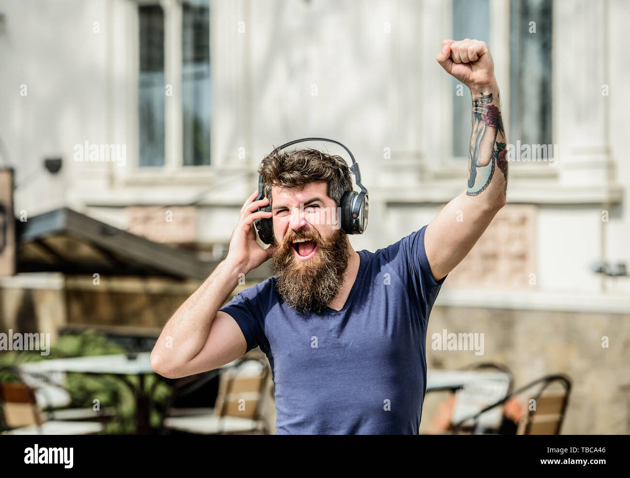 Man listen to music in headphones. brutal caucasian hipster with moustache. Music is my religion. Enjoying music. Mature hipster with beard. Sharing favorite music. Bearded man. - Stock Image