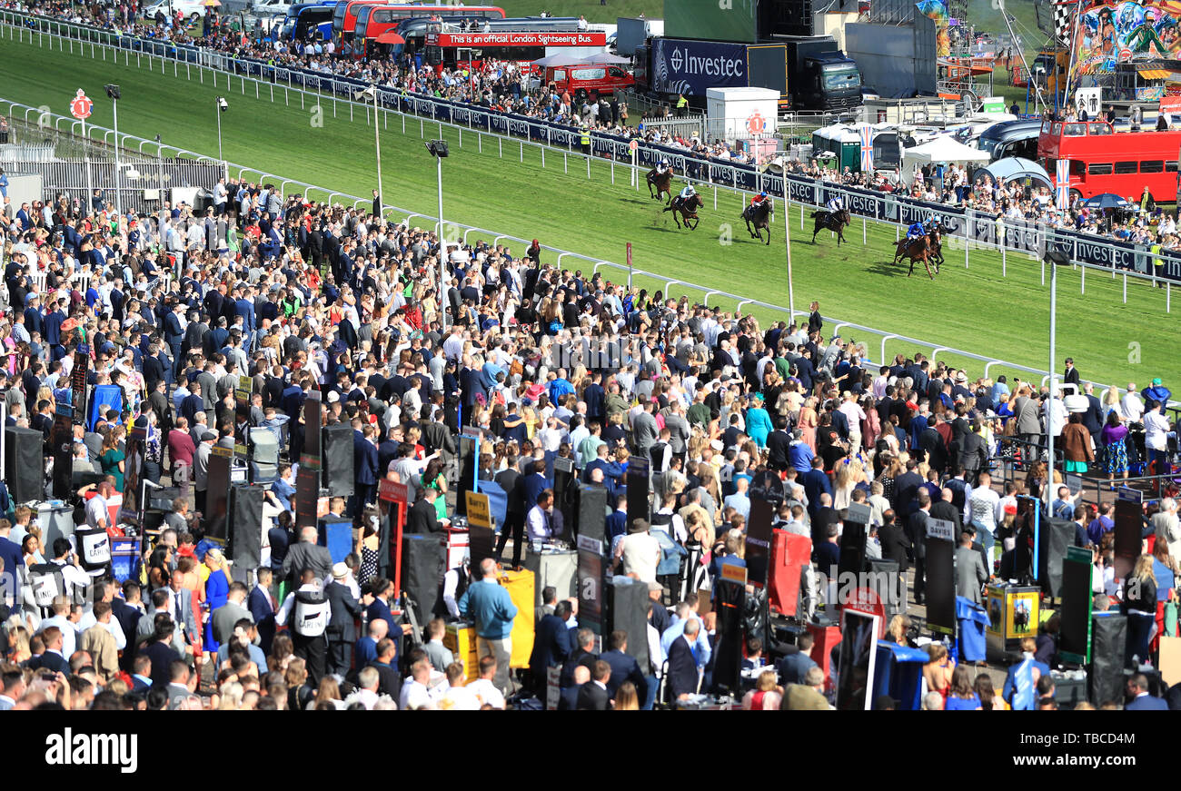 Runners and riders in the Investec Surrey Stakes during Ladies Day of the 2019 Investec Derby Festival at Epsom Racecourse, Epsom. - Stock Image