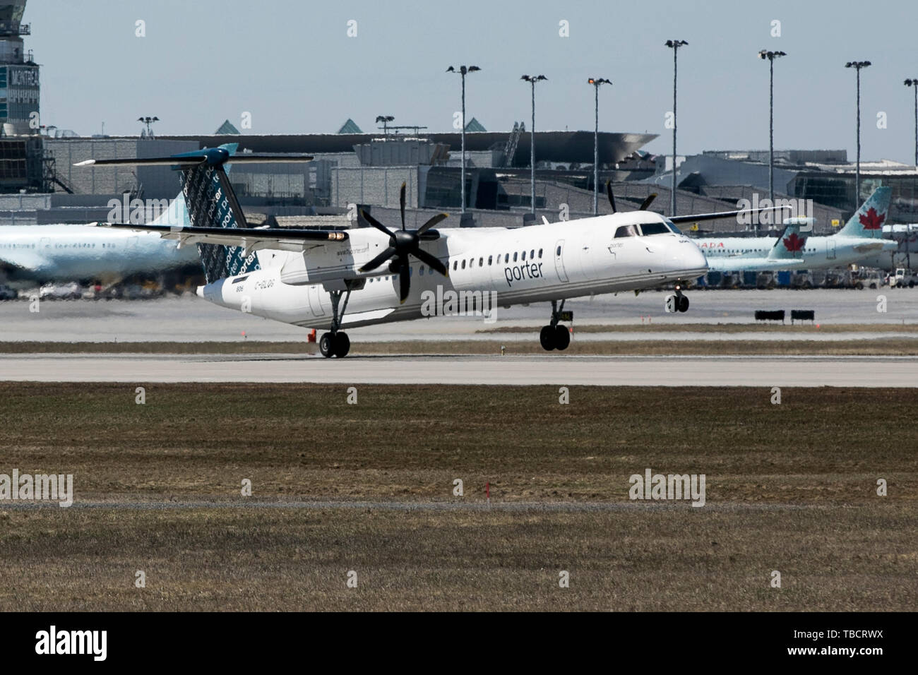 A Porter Airlines Bombardier Dash 8 airplane is seen landing at Montréal-Pierre Elliott Trudeau International Airport in Montreal, Quebec, Canada, on  - Stock Image