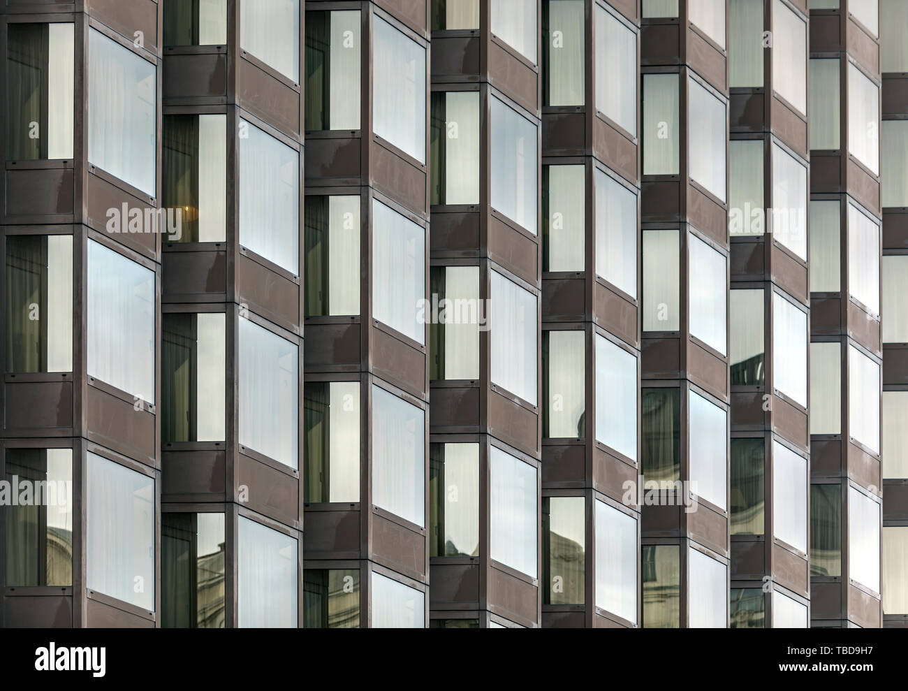 Geometrical photo of fragment of business center with many windows - Stock Image