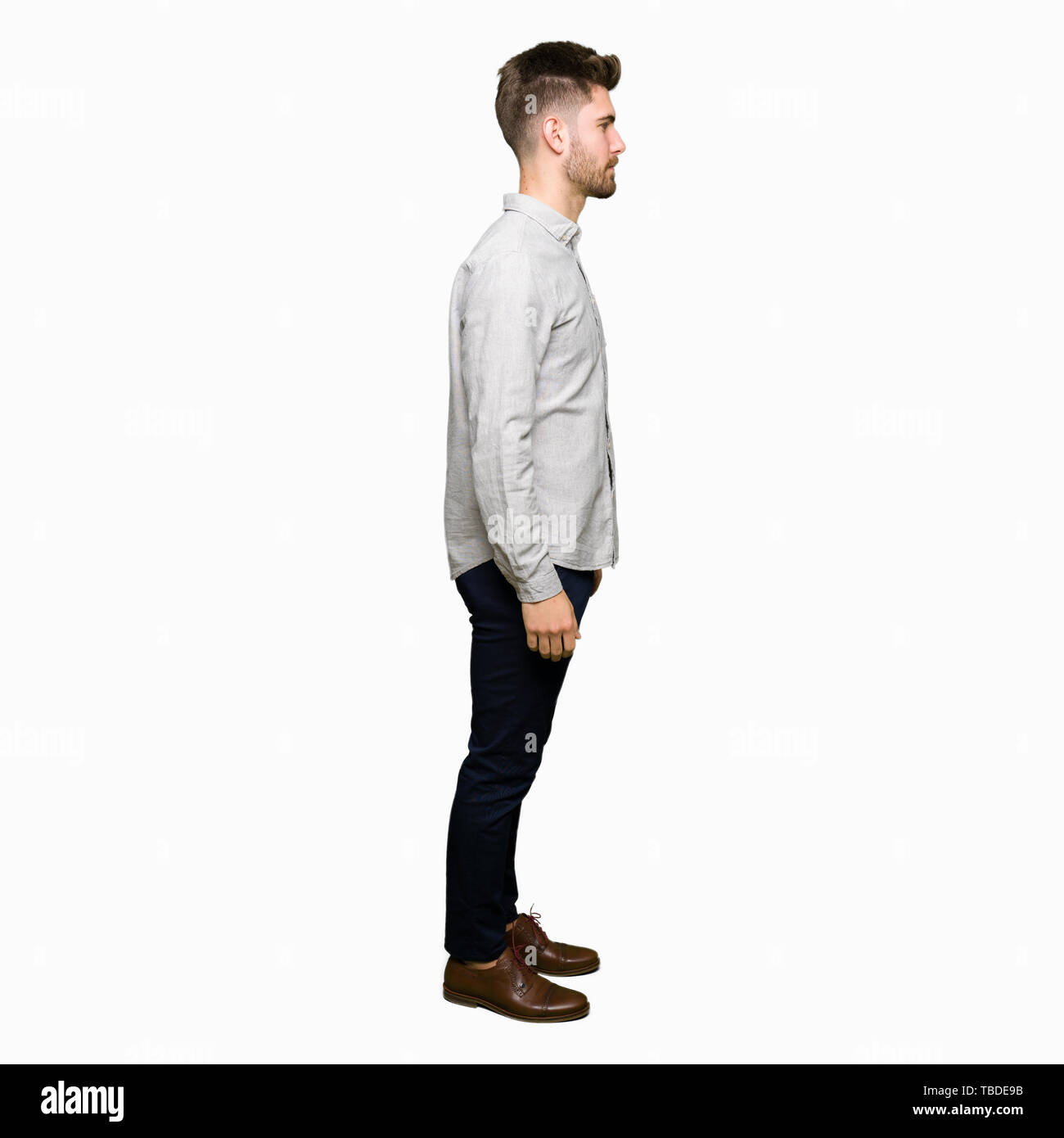 Young handsome man wearing casual shirt looking to side