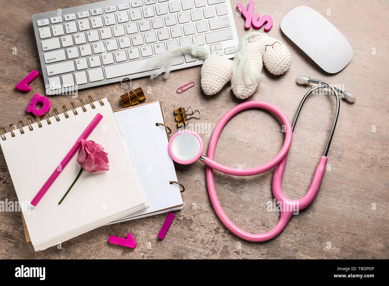 PC keyboard, stethoscope, stationery and toy on wooden background - Stock Image