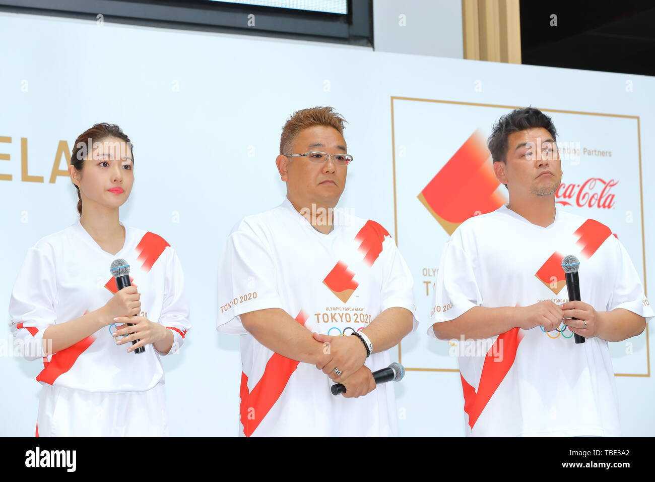 Tokyo, Japan. 1st June, 2019. (L-R) Satomi Ishihara, Mikio Date, Takeshi Tomizawa, The Tokyo Organising Committee of the Olympic and Paralympic Games (Tokyo 2020) holds commemorative event of Torch Relay in Tokyo, Japan on June 1, 2019, 300 days before of the Japanese leg of the Tokyo 2020 Olympic Torch Relay starts. The Organising Committee unveiled an official uniform, course outline and applicant guidelines for Torch Relay Runners. Credit: Naoki Nishimura/AFLO SPORT/Alamy Live News - Stock Image