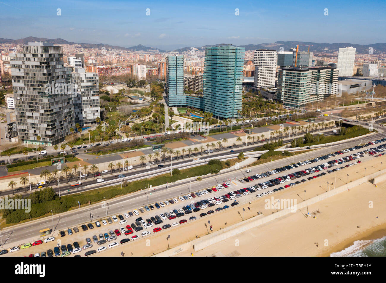 Aerial panoramic view of Barcelona modern neighborhood of Diagonal Mar i el Front Maritim del Poblenou on Mediterranean coast, Spain Stock Photo