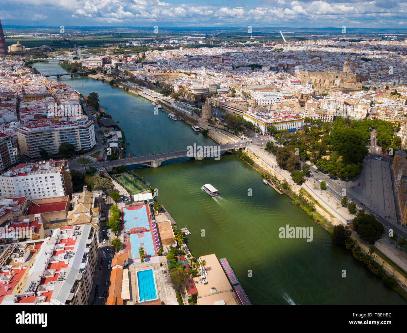Aerial panoramic view of modern cityscape of Seville with