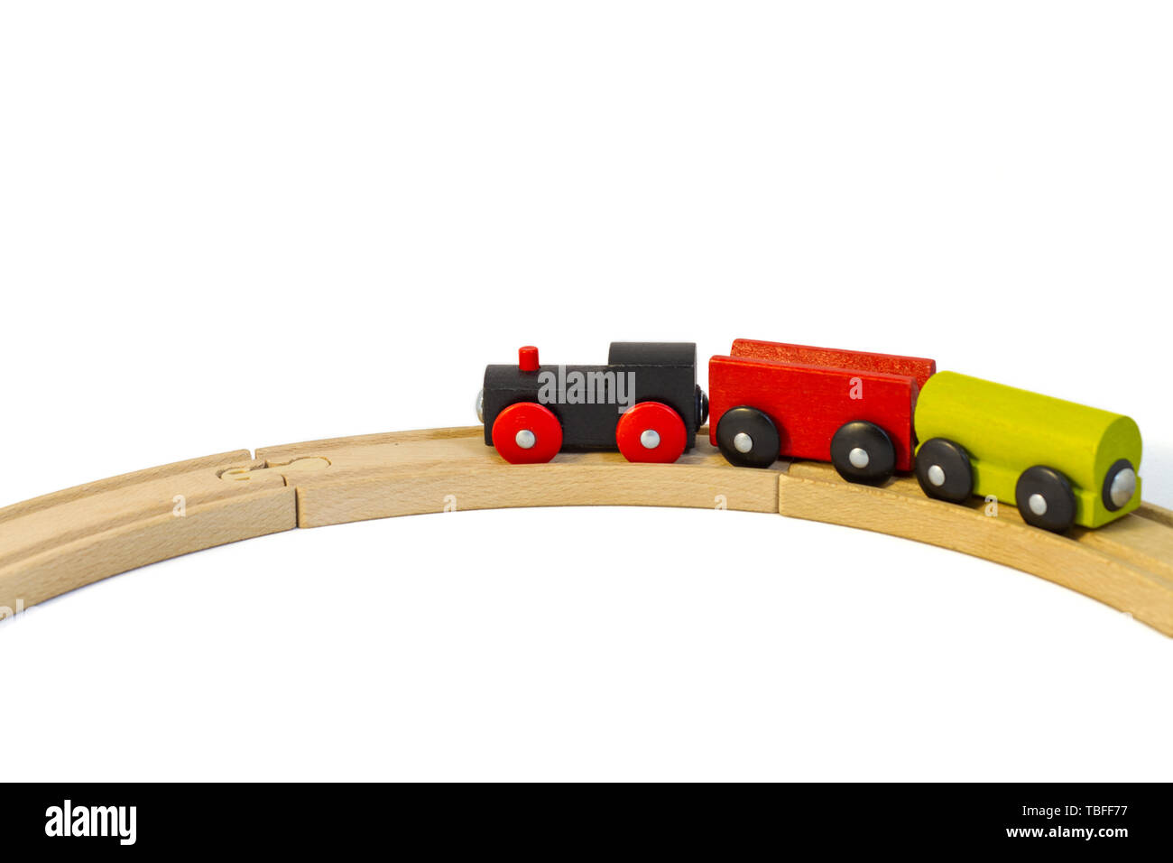 Colorful wooden toy train goes on rails. Isolated on white background. Perfect template, concept for promotion, ad, sale, poster, web-banner, article. - Stock Image