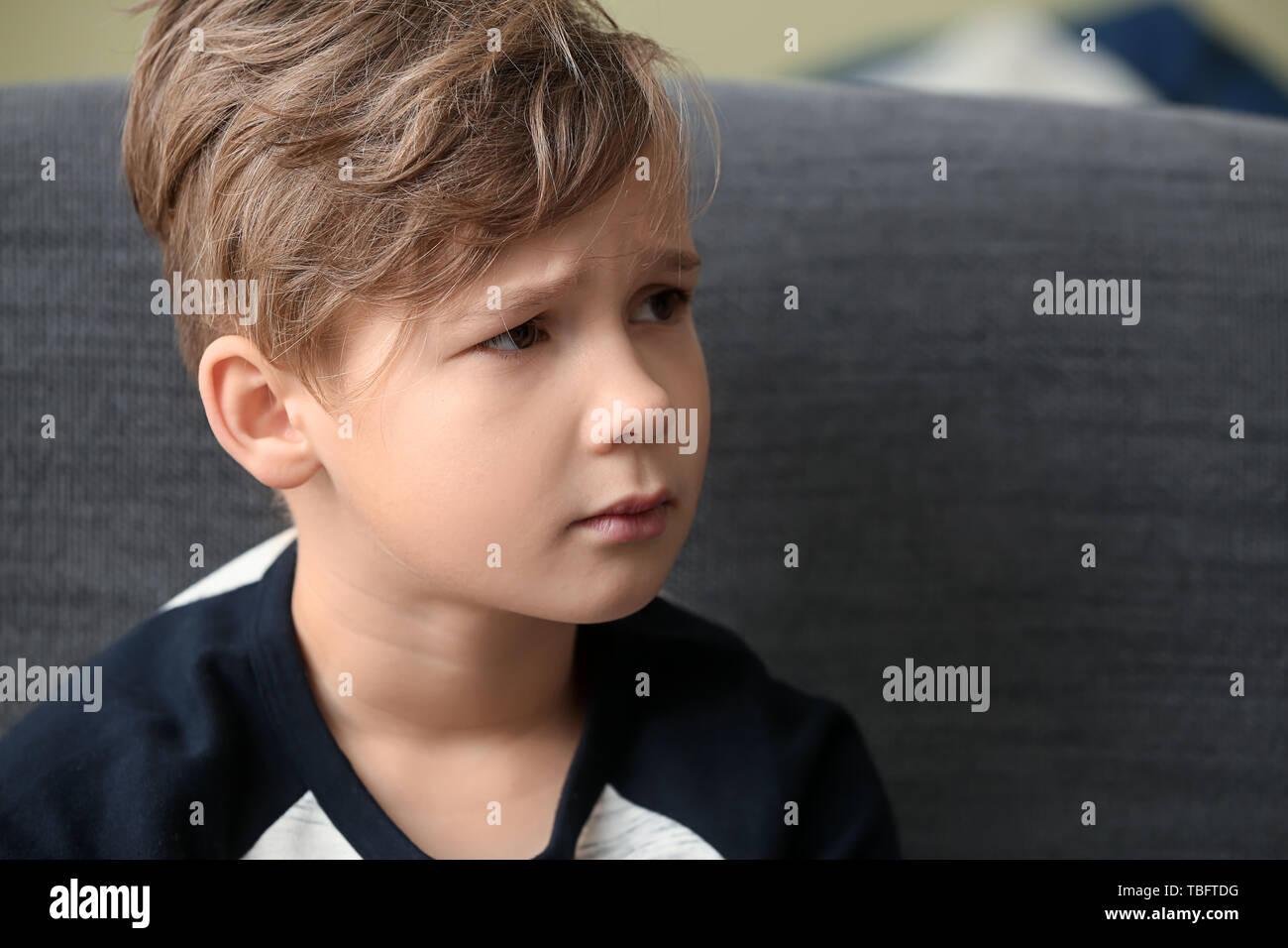 Sad little boy indoors - Stock Image