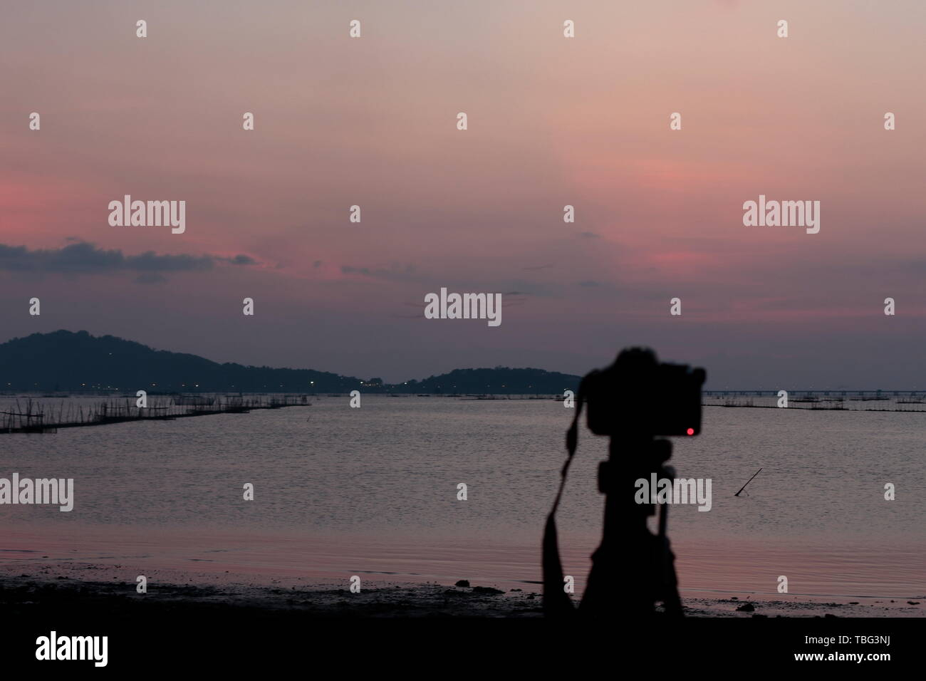Focus intention, landscape, sea, mountain and fishing tools, local fishermen Use the camera in the foreground. Stock Photo