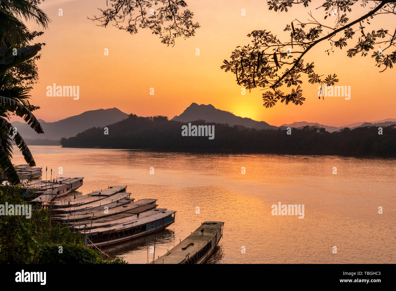 Mekong River at sunset in Luang Prabang, tour boats, Laos, southeast Asia Stock Photo