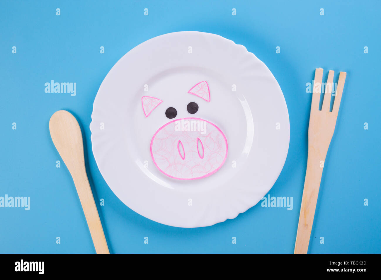 pork meat on the plate. cartoon styled - Stock Image