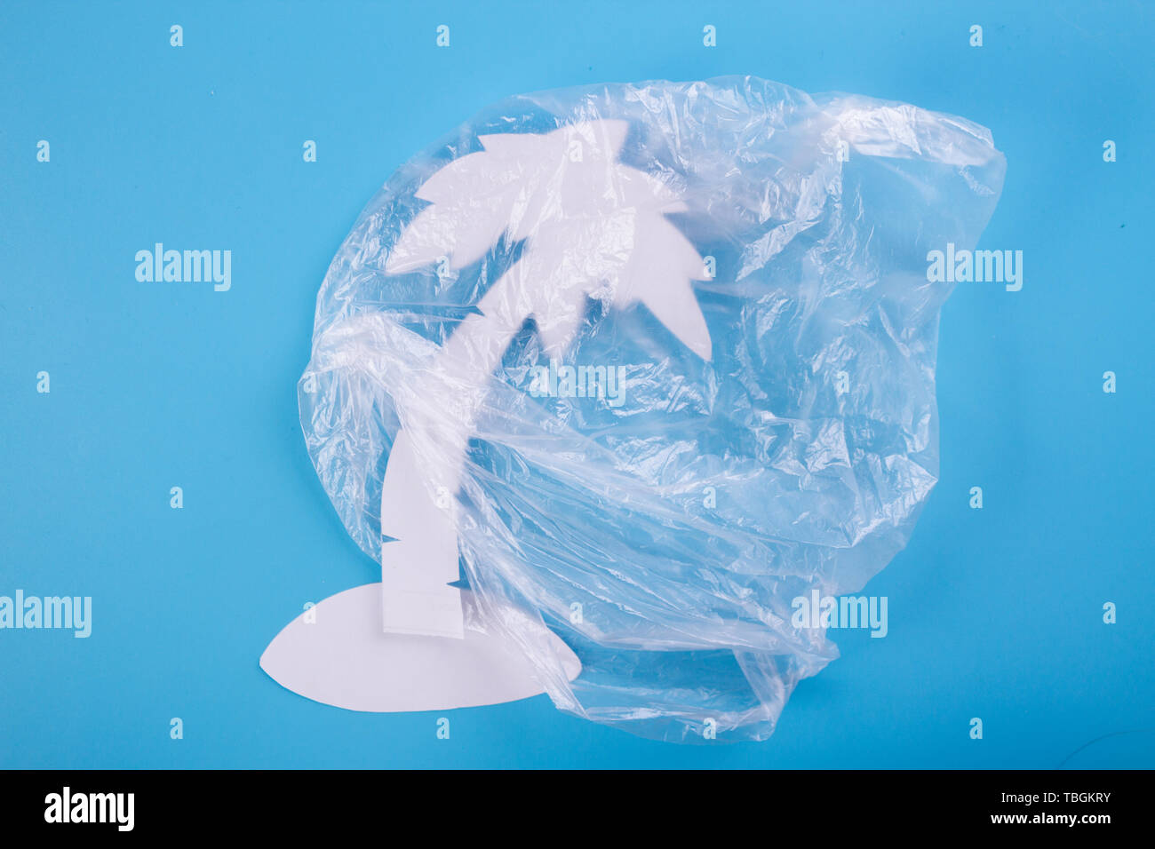 the Earth planet pollution concept. island in plastic bag - Stock Image