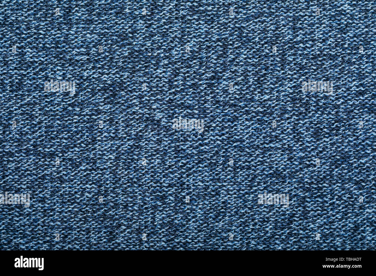 9343f68654c Dark blue melange knitted fabric made of heather mixed yarn textured  background
