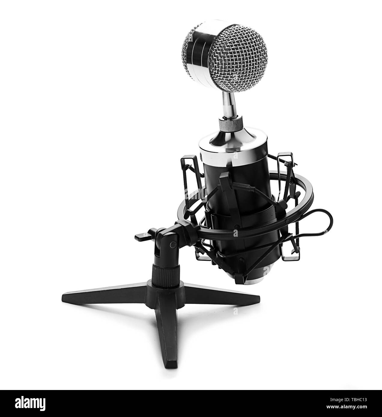 Microphone with stand on white background - Stock Image