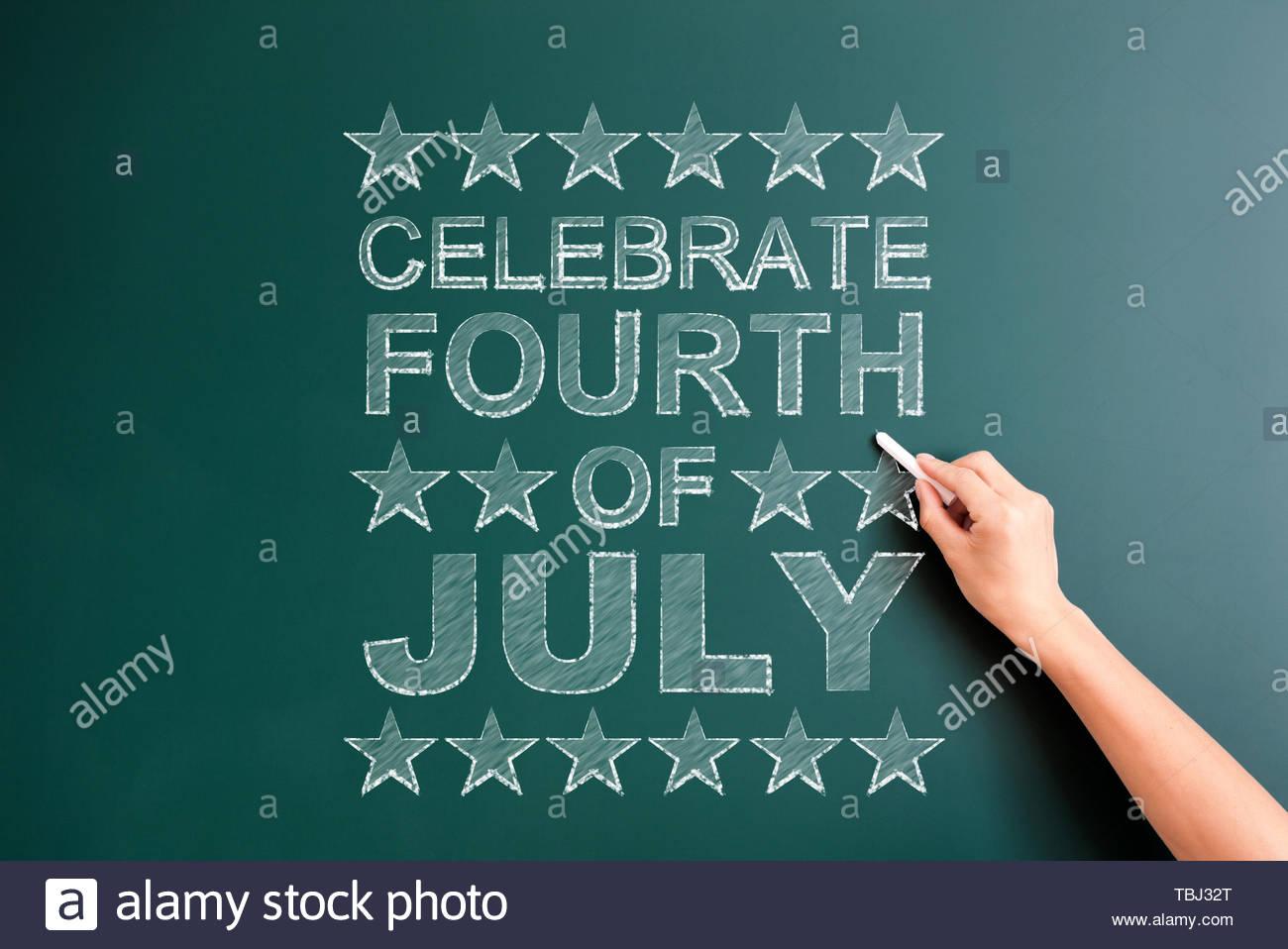 US national day slogan written on blackboard - Stock Image