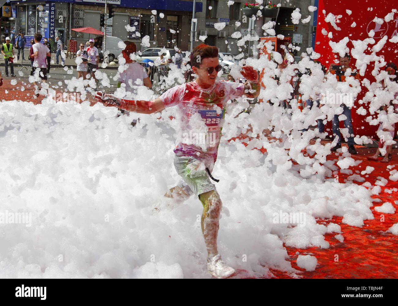 Kiev, Ukraine. 2nd June, 2019. A participant runs through the foam during the ''Kyiv Color Run'' in Kiev, Ukraine, on 2 June 2019. From the first event in the United States in January 2012 The Color Run has since spread across the globe leaving a trail of color and happy runners. Credit: Serg Glovny/ZUMA Wire/Alamy Live News - Stock Image