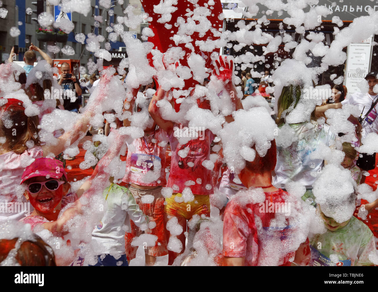 Kiev, Ukraine. 2nd June, 2019. Children play in the foam during the ''Kyiv Color Run'' in Kiev, Ukraine, on 2 June 2019. From the first event in the United States in January 2012 The Color Run has since spread across the globe leaving a trail of color and happy runners. Credit: Serg Glovny/ZUMA Wire/Alamy Live News - Stock Image