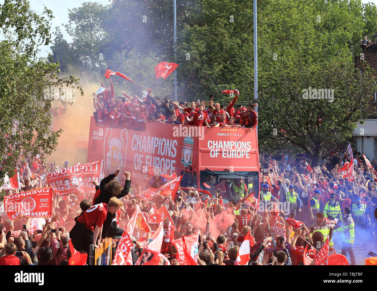 Liverpool, Merseyside. 2nd June, 2019. Liverpool FC celebration parade after their Champions League final win over Tottenham Hotspur in Madrid on 1st June; the Liverpool open top bus negotiates the Childwall Fiveways roundabout surrounded by a sea of fans Credit: Action Plus Sports/Alamy Live News Stock Photo