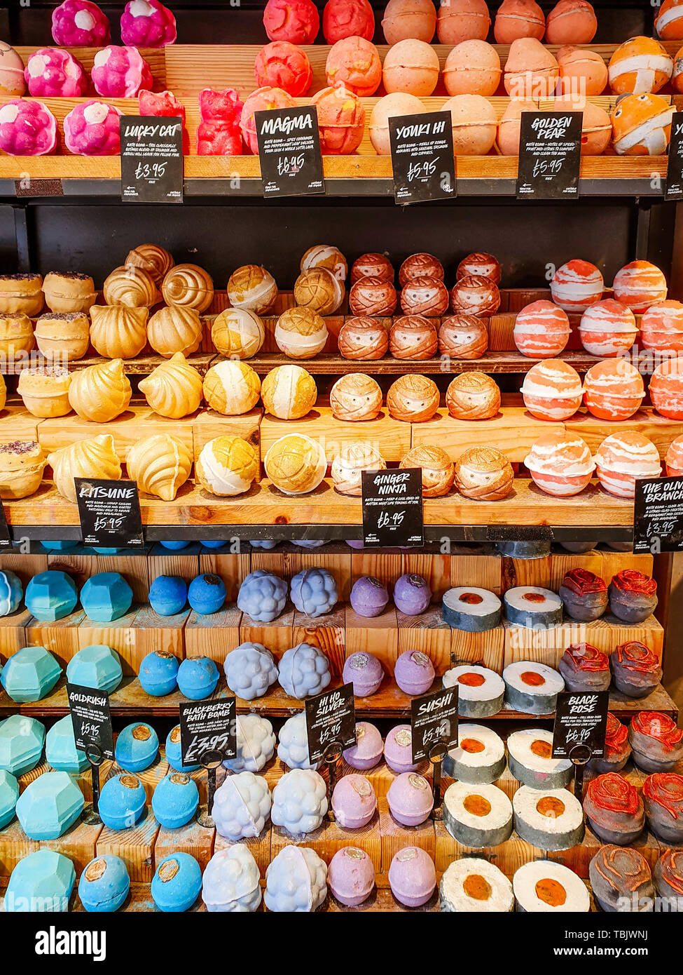 LEEDS, UK - JUNE 1ST 2019: Lush in Leeds city centre selling a variety of very colourful bath bombs - Stock Image