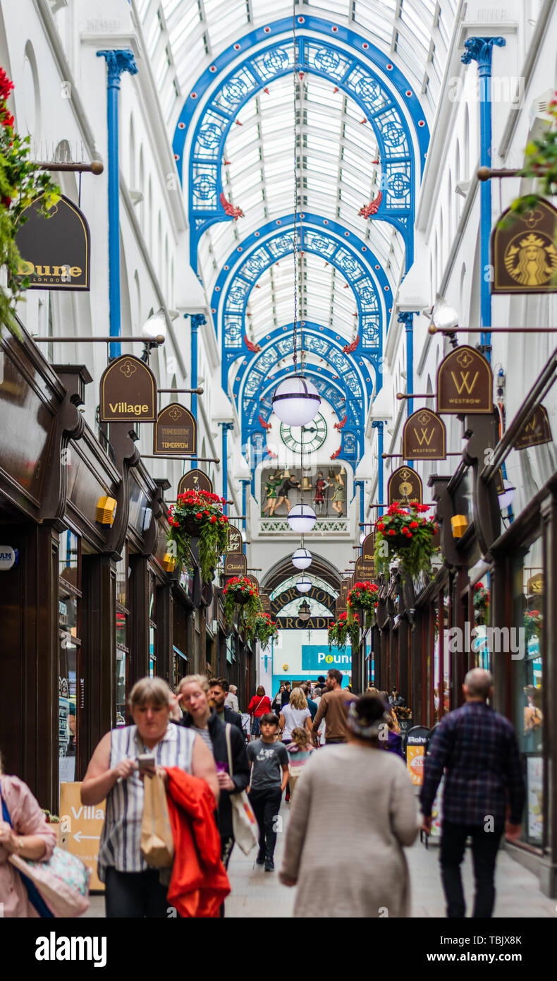 Thornton's Arcade in Leeds showing shops and customers - Stock Image