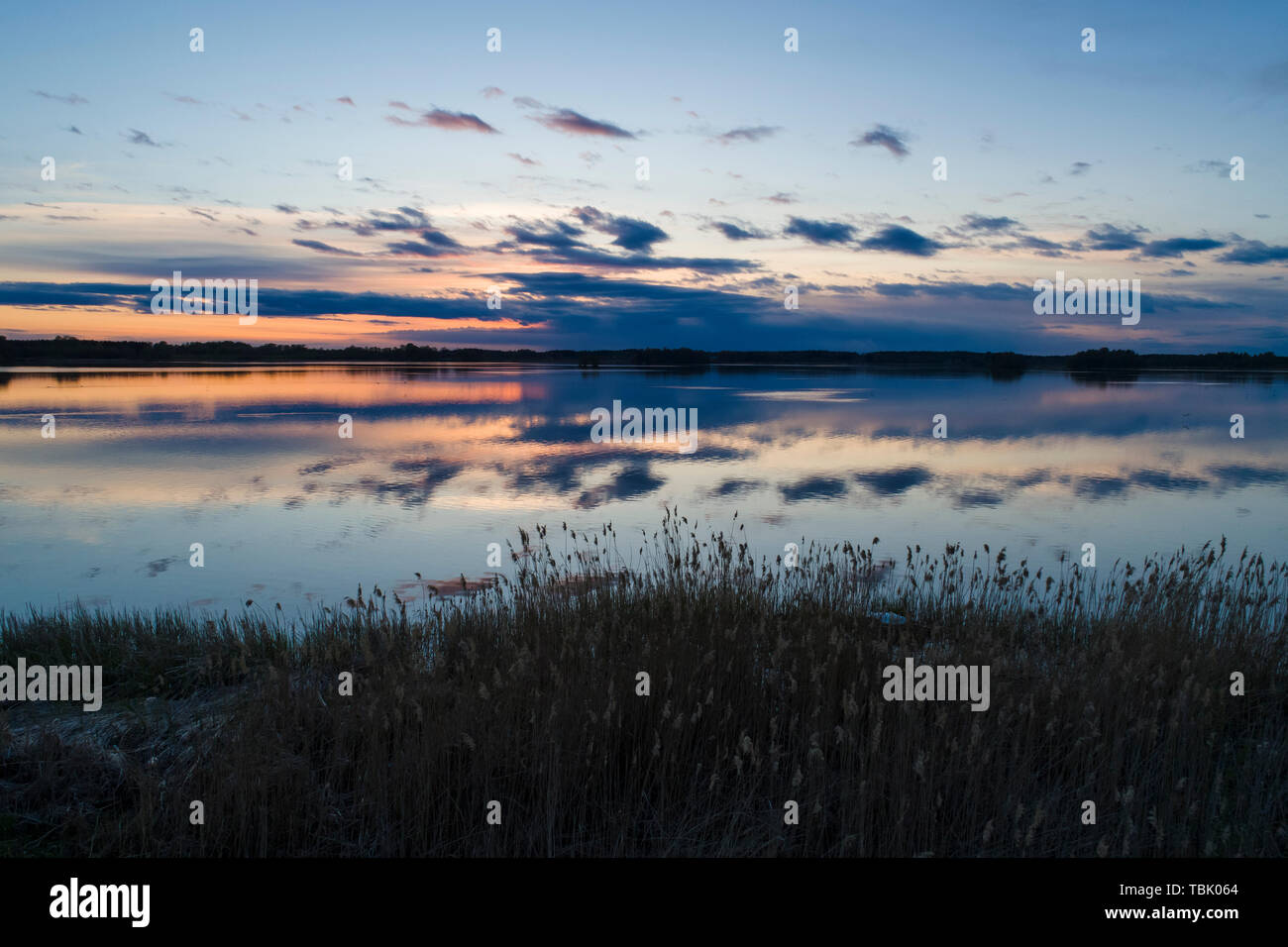 Beautiful nature and landscape photo of sunset in Katrineholm Sweden. Nice, calm and peaceful spring evening in Scandinavia. Picture shot with drone. - Stock Image
