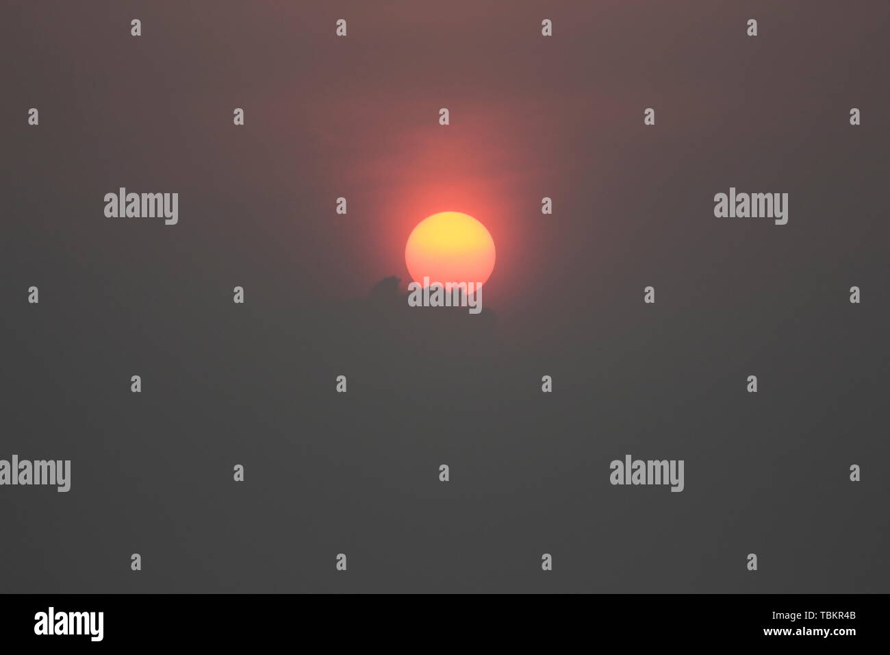 Big sun In the darkness of the clouds there is black - Stock Image