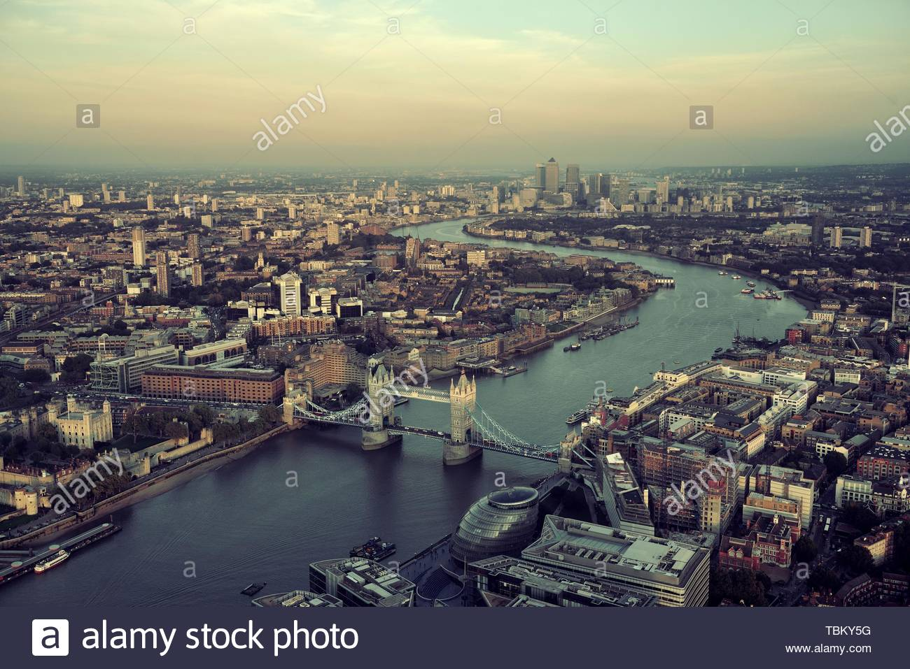 London rooftop view panorama at sunset with urban architectures and Thames River. - Stock Image