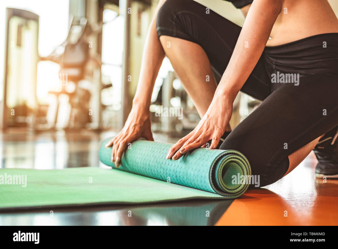 Close Up Of Sporty Woman Folding Yoga Mattress In Sport Fitness Gym Training Center Background Exercise Mat Rolling Keeping After Yoga Class Workout Stock Photo Alamy