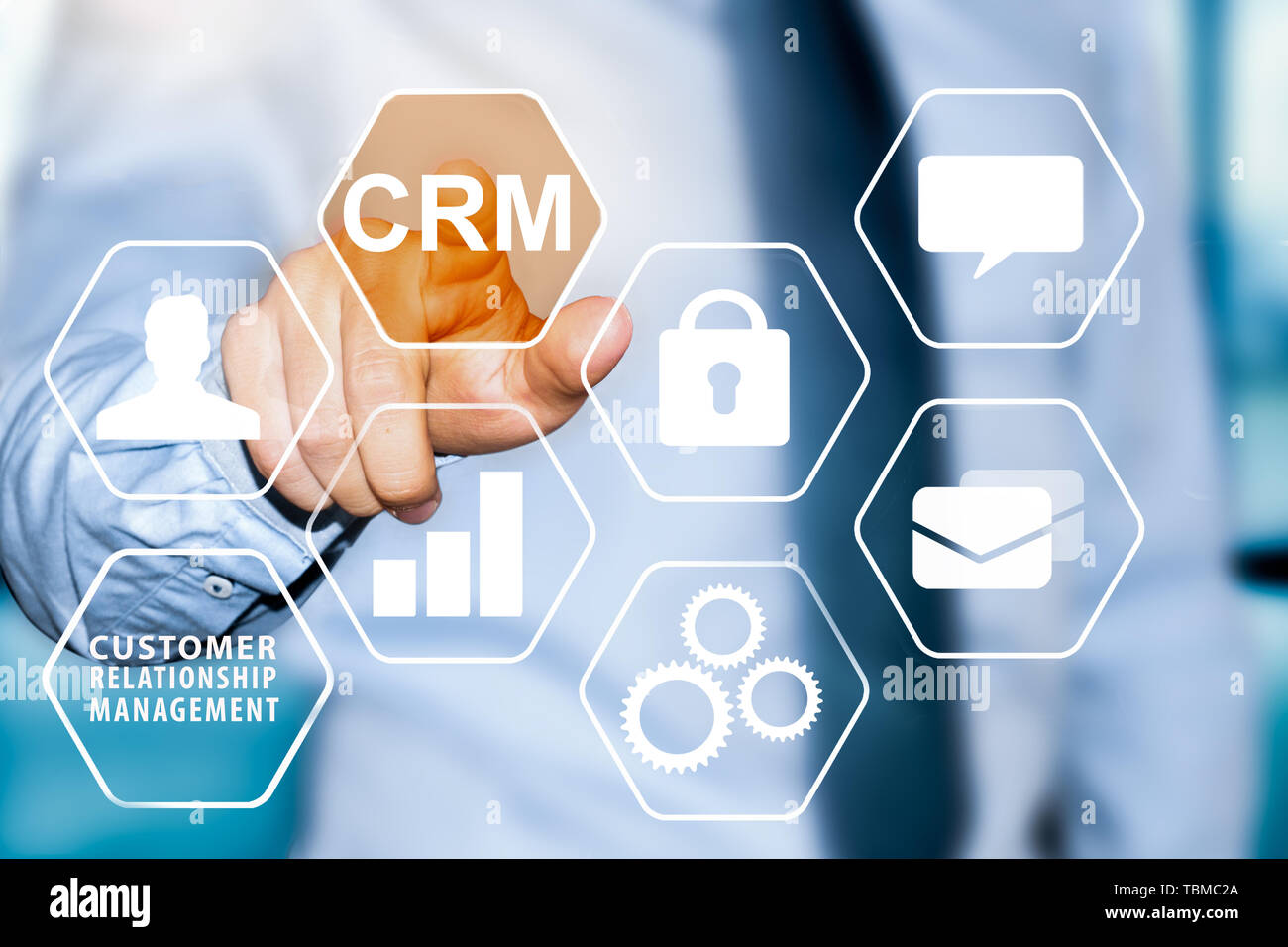 CRM Customer relationship management concept. businessman hand selecting CRM button. - Stock Image
