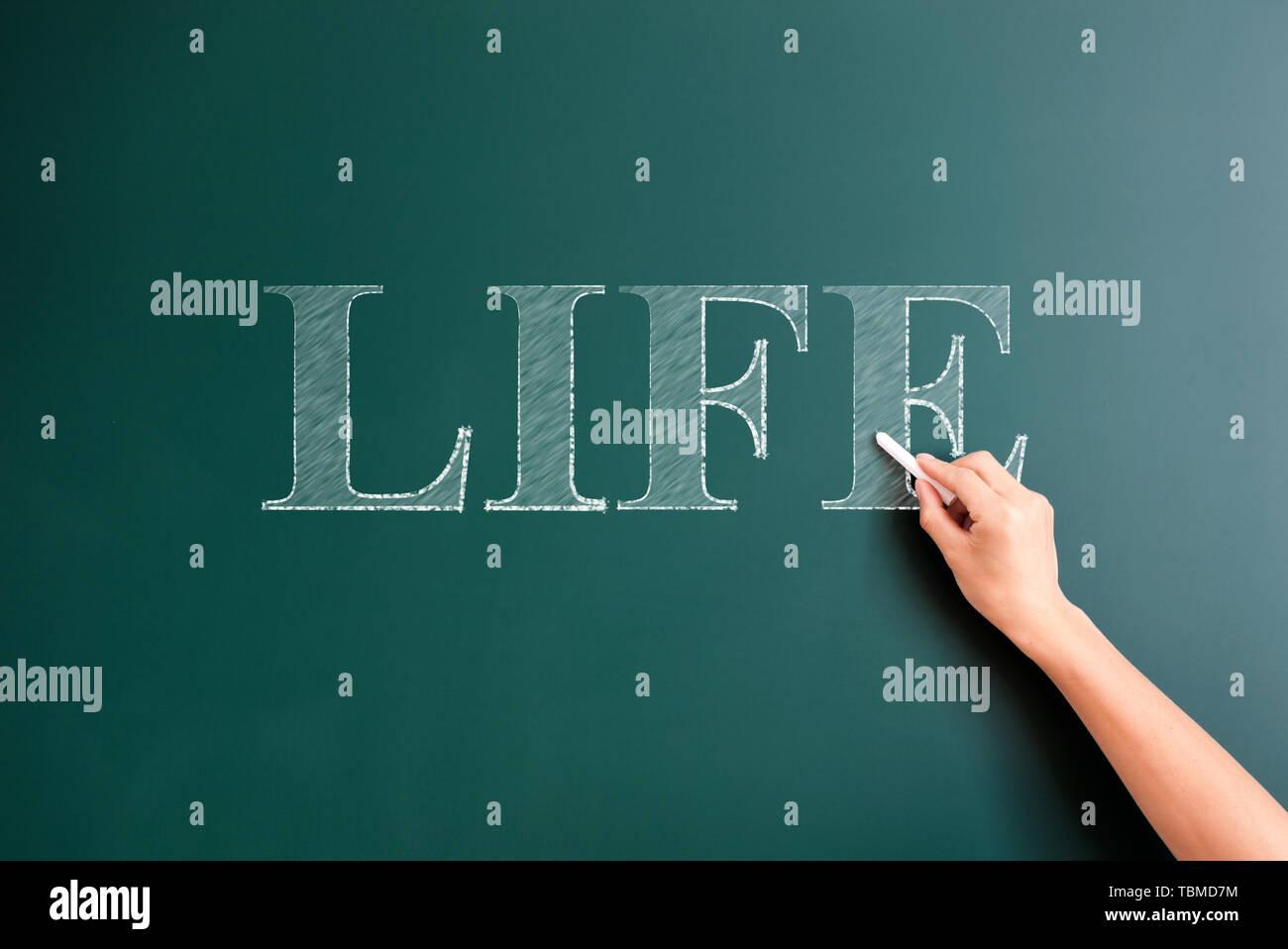 life written on blackboard - Stock Image