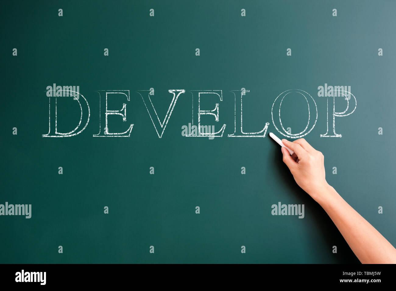 develop written on blackboard - Stock Image