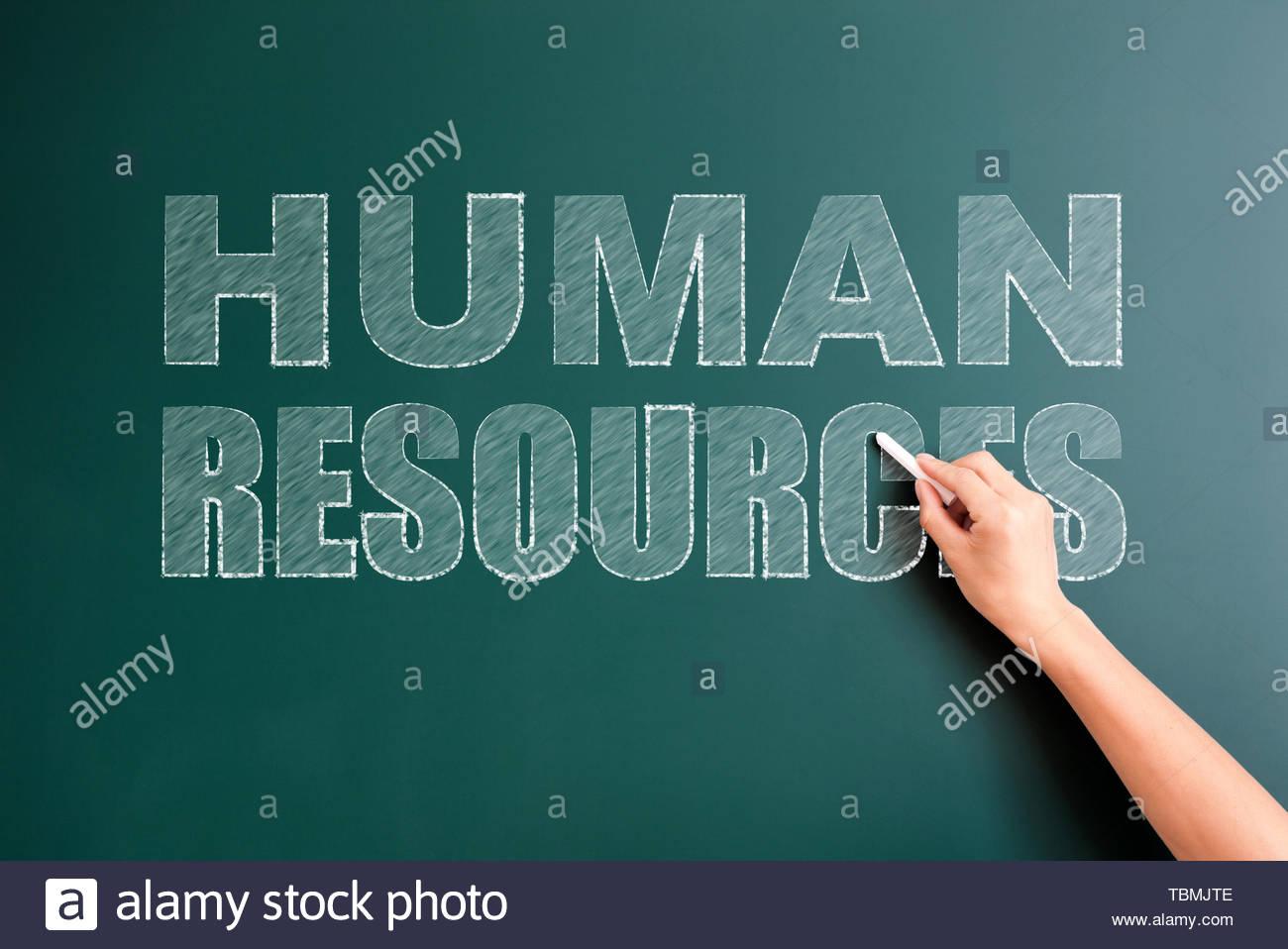 human resources written on blackboard - Stock Image