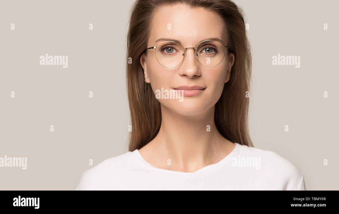 Unhealthy woman touch neck having sore throat or angina - Stock Image