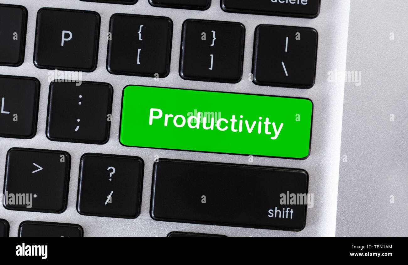 Text Productivity on green button of computer keyboard - Stock Image