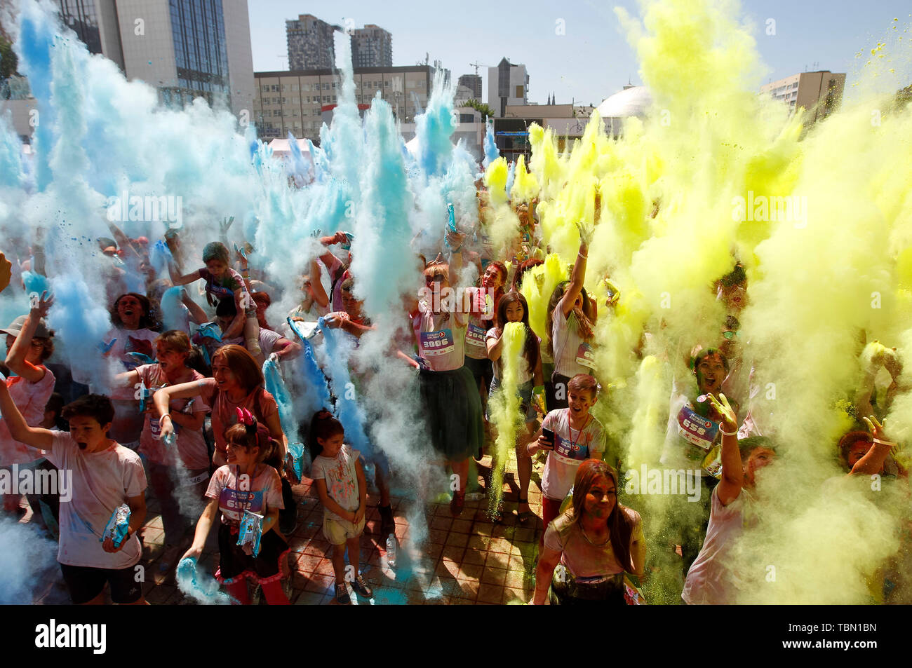 Colours being showered onto people during the event. The Color Run, also known as 'the happiest 5,000 meters on the planet', is an event series and paint race, its first event was in the United States in January 2012 since then the run has spread across the globe leaving a trail of color and happy runners across different continents and countries. The untimed event has no winners or prizes, but runners are showered with colored powder, made of food-grade corn starch, at stations along the run. In Ukrainian capital the first time Kyiv Color Run started in 2014. - Stock Image