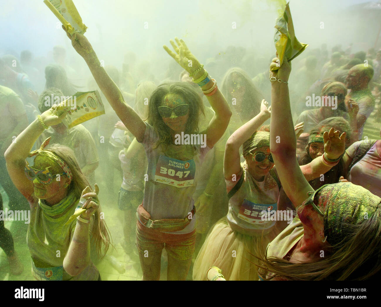 Peoples showered with colours having fun during the event. The Color Run, also known as 'the happiest 5,000 meters on the planet', is an event series and paint race, its first event was in the United States in January 2012 since then the run has spread across the globe leaving a trail of color and happy runners across different continents and countries. The untimed event has no winners or prizes, but runners are showered with colored powder, made of food-grade corn starch, at stations along the run. In Ukrainian capital the first time Kyiv Color Run started in 2014. - Stock Image