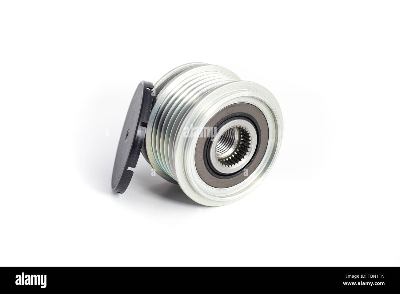 Freewheel alternator pulley on isolated white background with cap. Auto electrical parts. - Stock Image