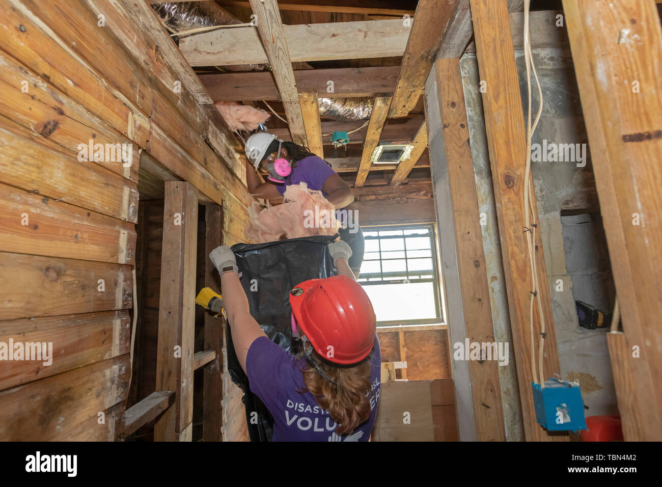 Panama City, Florida - Volunteers repair a home damaged when Hurricane Michael hit the Florida Panhandle. Extensive damage to roofs during the Categor - Stock Image
