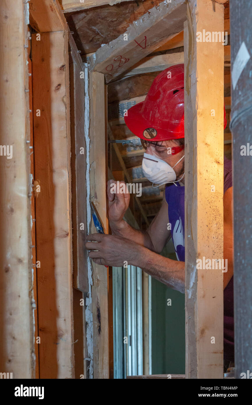 Lynn Haven, Florida - Volunteers repair a home damaged when Hurricane Michael hit the Florida Panhandle. Extensive damage to roofs during the Category - Stock Image
