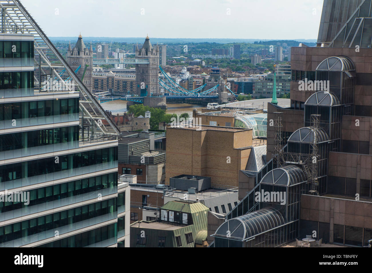 A view of the City of London offices with Tower Bridge in the distance - Stock Image