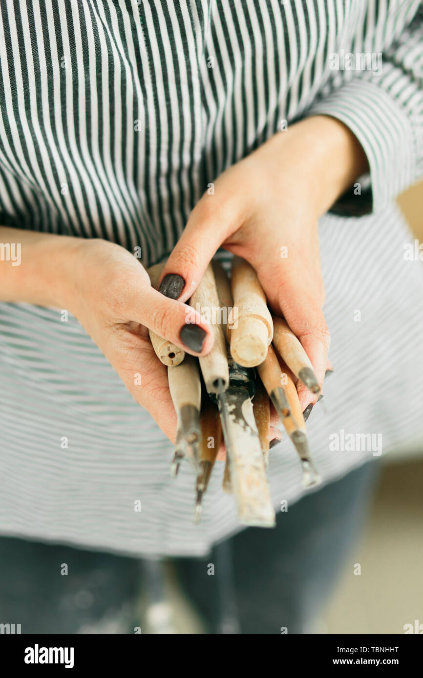 pottery tools for carving ceramic products in workshop - Stock Image
