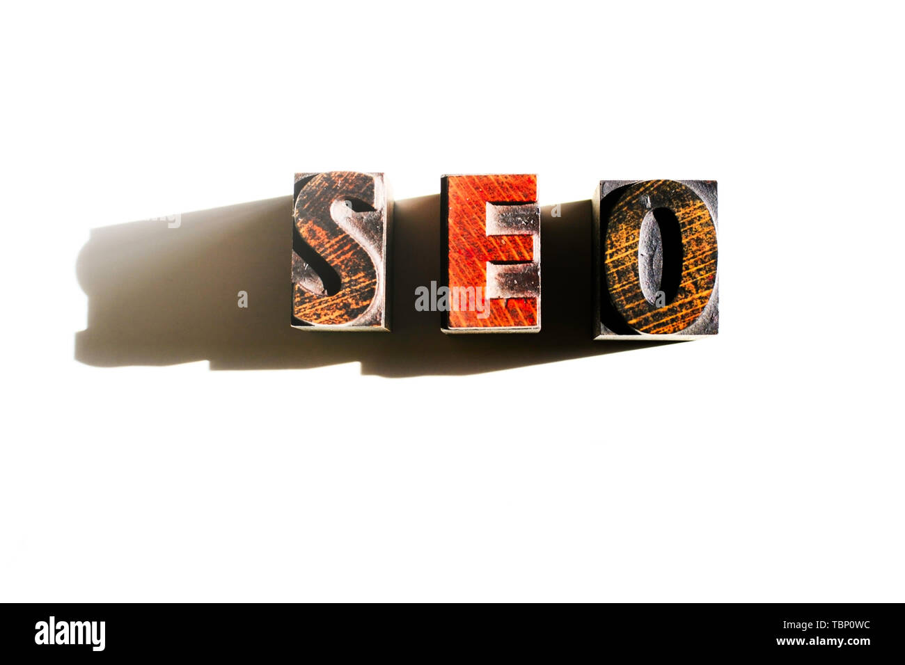SEO text showing the importance of Search Engine Optimisation for better search results and increase traffic for online business - Stock Image