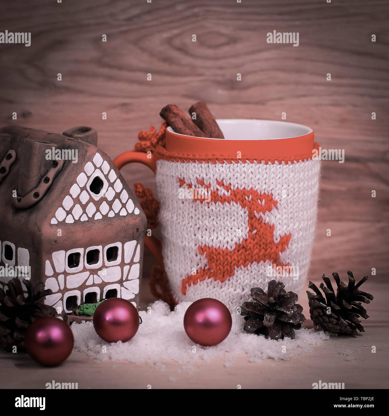 Christmas Cup and a gingerbread house on a wooden table .photo with space for text - Stock Image